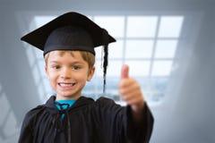 Immagine composita dell'allievo sveglio in abito di graduazione Fotografia Stock Libera da Diritti