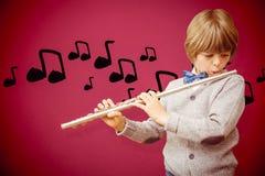 Immagine composita dell'allievo sveglio che gioca flauto Fotografie Stock Libere da Diritti