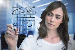 Immagine composita dell'indicatore concentrato di lavagna della tenuta della donna di affari Fotografia Stock