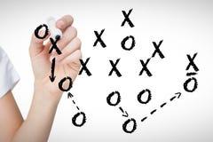 Immagine composita dell'indicatore femminile di lavagna della tenuta della mano Immagine Stock