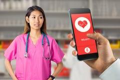 Immagine composita dell'infermiere asiatico con lo stetoscopio che esamina la macchina fotografica Fotografia Stock Libera da Diritti