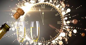 Immagine composita dell'orologio che conta alla rovescia alla mezzanotte fotografia stock