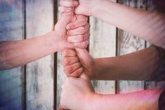 Immagine composita dell'immagine potata della gente che impila i pugni Immagine Stock Libera da Diritti