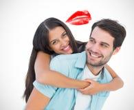 Immagine composita dell'uomo casuale felice che dà a due vie grazioso dell'amica Fotografia Stock