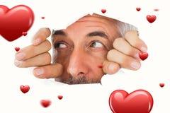 Immagine composita dell'uomo che guarda attraverso la carta lacerata Immagini Stock Libere da Diritti
