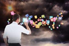 Immagine composita dell'uomo d'affari bello che indica ad uno spazio 3d della copia Immagini Stock