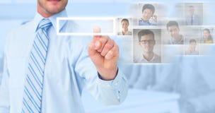 Immagine composita dell'uomo d'affari in camicia che indica con il suo dito Fotografia Stock