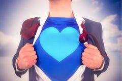 Immagine composita dell'uomo d'affari che apre il suo stile del supereroe della camicia Fotografia Stock Libera da Diritti
