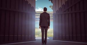Immagine composita dell'uomo d'affari che gira il suo di nuovo alla macchina fotografica 3d Fotografia Stock