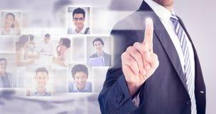 Immagine composita dell'uomo d'affari che indica con il suo dito immagini stock libere da diritti