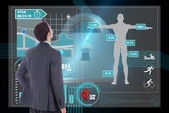 Immagine composita dell'uomo d'affari che sta con la mano sull'anca Immagini Stock