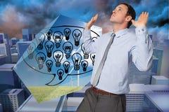 Immagine composita dell'uomo d'affari che sta con le armi che spingono verso l'alto Fotografia Stock Libera da Diritti