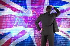 Immagine composita dell'uomo d'affari che sta di nuovo alla macchina fotografica con la mano sulla testa Immagine Stock
