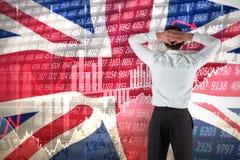 Immagine composita dell'uomo d'affari che sta di nuovo alla macchina fotografica con le mani sulla testa Immagine Stock