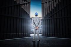Immagine composita dell'uomo d'affari con il casco che gira il suo di nuovo alla macchina fotografica 3d Fotografie Stock Libere da Diritti