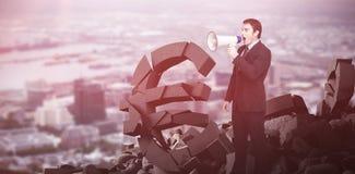 Immagine composita dell'uomo d'affari diritto che grida tramite un megafono Immagini Stock Libere da Diritti