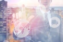 Immagine composita dell'uomo d'affari facendo uso dello schermo digitale futuristico 3D Immagini Stock Libere da Diritti
