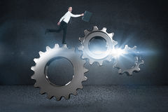 Immagine composita dell'uomo d'affari felice che salta con la sua cartella Immagine Stock Libera da Diritti
