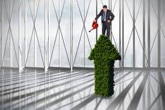Immagine composita dell'uomo d'affari maturo facendo uso dell'annaffiatoio Immagini Stock Libere da Diritti