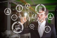 Immagine composita dell'uomo d'affari premuroso che indica qualcosa con il suo dito Immagine Stock