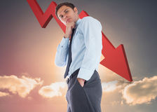 Immagine composita dell'uomo d'affari premuroso con la mano sul mento Fotografia Stock Libera da Diritti