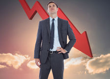 Immagine composita dell'uomo d'affari serio con la mano sull'anca Fotografia Stock