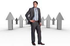 Immagine composita dell'uomo d'affari serio con la mano sull'anca Immagini Stock Libere da Diritti