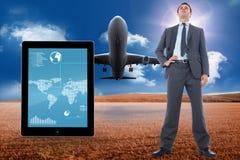 Immagine composita dell'uomo d'affari serio con la mano sull'anca Fotografie Stock Libere da Diritti