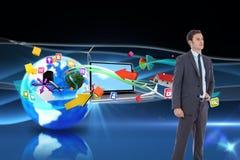 Immagine composita dell'uomo d'affari serio con la mano sull'anca Fotografia Stock Libera da Diritti