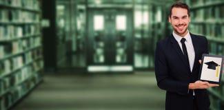 Immagine composita dell'uomo d'affari sorridente che mostra il suo pc della compressa Fotografia Stock Libera da Diritti