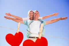 Immagine composita dell'uomo senior felice che dà al suo partner un a due vie illustrazione di stock