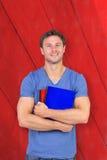 Immagine composita dell'uomo sorridente che esamina macchina fotografica Immagini Stock