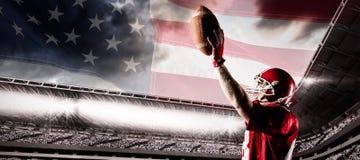 Immagine composita della condizione del giocatore di football americano con il casco e la palla di rugby immagini stock libere da diritti