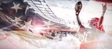 Immagine composita della condizione del giocatore di football americano con le armi su immagine stock libera da diritti