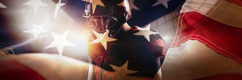 Immagine composita della condizione del giocatore di football americano nel casco immagini stock libere da diritti