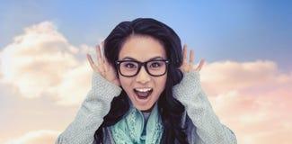 Immagine composita della donna asiatica che grida alla macchina fotografica Immagine Stock Libera da Diritti