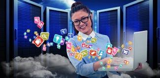 Immagine composita della donna asiatica che per mezzo del computer portatile 3d Fotografia Stock Libera da Diritti