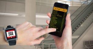 Immagine composita della donna che per mezzo dello smartwatch e del telefono Immagine Stock Libera da Diritti