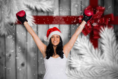 Immagine composita della donna che porta i guantoni da pugile rossi Fotografie Stock Libere da Diritti