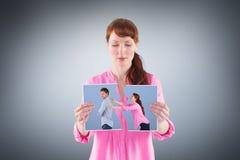 Immagine composita della donna che prova ad abbracciare uomo Fotografia Stock