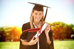 Immagine composita della donna che sorride alla sua graduazione Fotografia Stock Libera da Diritti