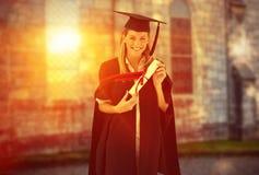 Immagine composita della donna che sorride alla sua graduazione Fotografie Stock Libere da Diritti