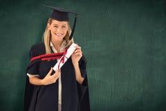 Immagine composita della donna che sorride alla sua graduazione Fotografia Stock