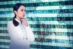 Immagine composita della donna di affari asiatica che tocca il suo mento Fotografie Stock