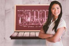 Immagine composita della donna di affari casuale che esamina macchina fotografica con le armi attraversate Fotografia Stock Libera da Diritti