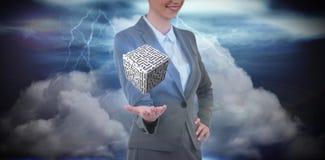 Immagine composita della donna di affari che gesturing contro il fondo apocalittico Immagine Stock