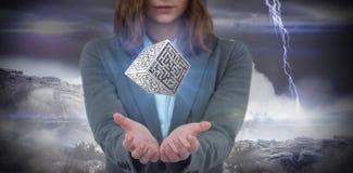 Immagine composita della donna di affari che gesturing contro il fondo apocalittico Fotografia Stock