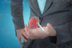 Immagine composita della donna di affari che gesturing contro il fondo bianco 3D Fotografie Stock Libere da Diritti