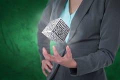 Immagine composita della donna di affari che gesturing contro il fondo verde Fotografia Stock Libera da Diritti