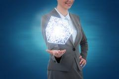Immagine composita della donna di affari che gesturing sul fondo blu Fotografia Stock Libera da Diritti